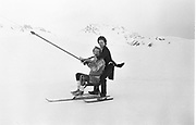 Mike Fitzroy and Hugo Spowers, , Dangerous Sports club ski race, St. Moritz. 1983. © Copyright Photograph by Dafydd Jones 66 Stockwell Park Rd. London SW9 0DA Tel 020 7733 0108 www.dafjones.com