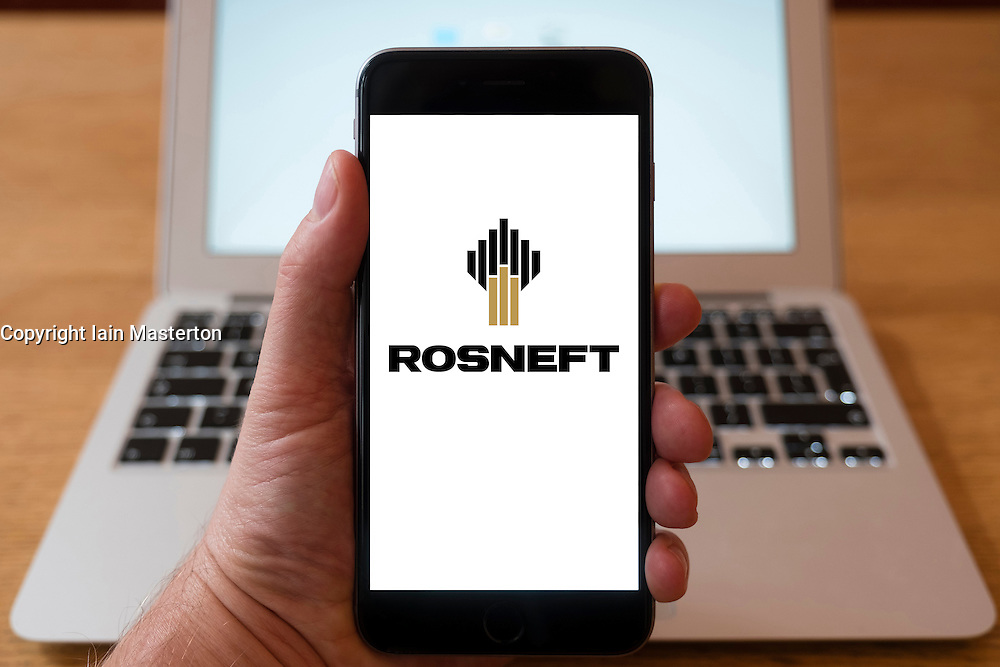 Using iPhone smartphone to display logo of Rosneft , Russian oil and gas company