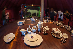 © Licensed to London News Pictures. 22/08/2015. Weston-super-Mare, North Somerset, UK.  Picture of work by RONIT BARANGA (foreground) and DAMIEN HIRST (unicorn in glass case at back) in the Circus tent on the first main day of BANKSY's Dismaland show at the old Tropicana on Weston seafront, when the event is open to the general public. Photo credit : Simon Chapman/LNP