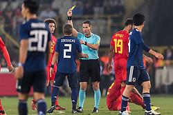 referee Danny Makkelie give a yellow card to Yosuke Ideguchi of Japan during the friendly match between Belgium and Japan on November 14, 2017 at the Jan Breydel stadium in Bruges, Belgium.