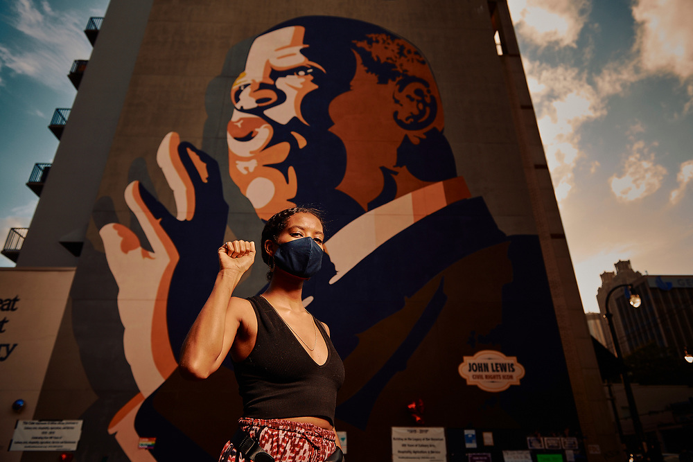 On the day of the memorial service for John Lewis, Atlantans pay their respects at the John Lewis Mural on Auburn Avenue in downtown Atlanta.