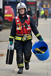 © Licensed to London News Pictures. 16/11/2012. Streatham, UK An officer from the Fire Investigation Team. Two people have died and another is in hospital with burns after a fire on wasteland in south London. Firefighters were called to the scene in Streatham High Road, Streatham, just after 02:20 GMT. Two bodies were found at the scene and a third person was taken to hospital for treatment. Crews took just over an hour to bring the fire under control. The incident is being investigated by the London Fire Brigade and the Metropolitan Police. Photo credit : Stephen Simpson/LNP