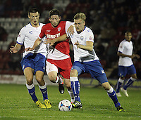Kidderminster Harriers' Callum Gittings battles with FC Halifax Town's Marc Roberts (right) and Matty Pearson<br /> <br /> (Photo by Rich Linley/CameraSport)<br /> <br /> Football - The Skrill Premier - Kidderminster Harriers v FC Halifax Town - Tuesday 24th September 2013 - Aggborough Stadium - Kidderminster<br /> <br /> © CameraSport - 43 Linden Ave. Countesthorpe. Leicester. England. LE8 5PG - Tel: +44 (0) 116 277 4147 - admin@camerasport.com - www.camerasport.com