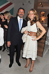 A reception in honour of David Linley to recognise his ambassadorial role for Ruinart Champagne held at Linley, Pimlico Road, London on 24th October 2012.<br /> Picture shows:-SIR ROCCO & LADY FORTE.