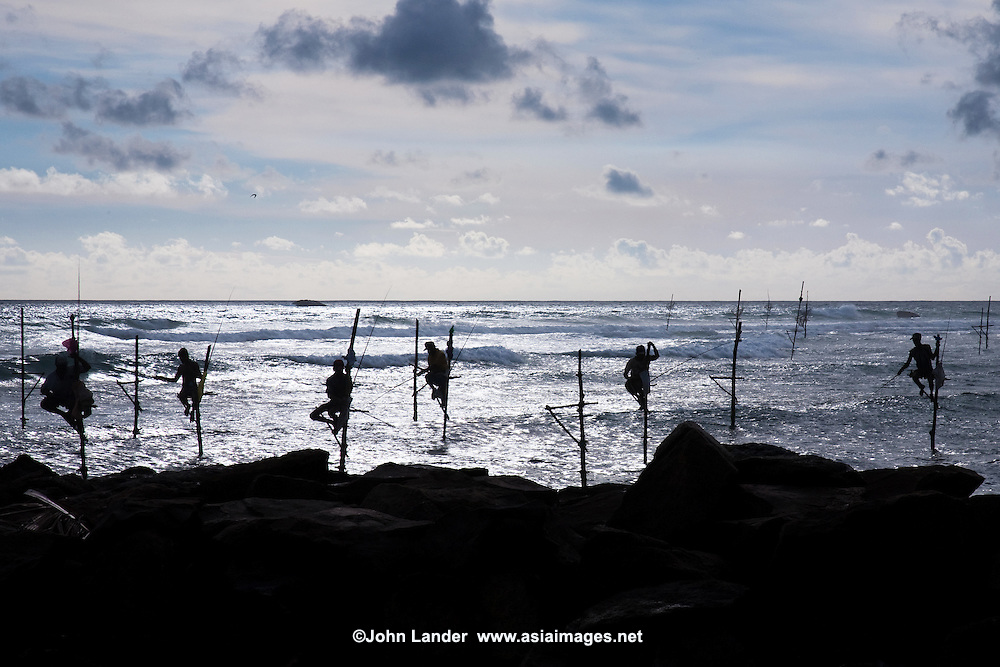 Sri Lankan Stilt Fishermen - Stilt fishing is fishing in relatively shallow water on a platform made up of a stilt. This is a common method used by Sri Lankan fisherman when fishing in or arround reefs not far away from the shore.  Most of the stilt fishing is done along the South Coast of Sri Lanka near the village of Kogala.