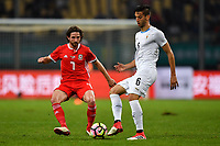 """Joe Allen, left, of Wales national football team kicks the ball to make a pass against Rodrigo Bentancur of Uruguay national football team in their final match during the 2018 Gree China Cup International Football Championship in Nanning city, south China's Guangxi Zhuang Autonomous Region, 26 March 2018.<br /> <br /> Edinson Cavani's goal in the second half helped Uruguay beat Wales to claim the title of the second edition of China Cup International Football Championship here on Monday (26 March 2018). """"It was a tough match. I'm very satisfied with the result and I think that we can even get better if we didn't suffer from jet lag or injuries. I think the result was very satisfactory,"""" said Uruguay coach Oscar Tabarez. Wales were buoyed by a 6-0 victory over China while Uruguay were fresh from a 2-0 win over the Czech Republic. Uruguay almost took a dream start just 3 minutes into the game as Luis Suarez's shot on Nahitan Nandez cross smacked the upright. Uruguay were dealt a blow on 8 minutes when Jose Gimenez was injured in a challenge and was replaced by Sebastian Coates. Inter Milan's midfielder Matias Vecino of Uruguay also fired at the edge of box from a looped pass but only saw his attempt whistle past the post. Suarez squandered a golden opportunity on 32 minutes when Ashley Williams's wayward backpass sent him clear, but the Barca hitman rattled the woodwork again with goalkeeper Wayne Hennessey well beaten."""