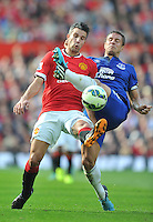 Manchester United's Robin van Persie is tackled by Everton's Phil Jagielka<br /> <br /> Photographer Dave Howarth/CameraSport<br /> <br /> Football - Barclays Premiership - Manchester United v Everton - Sunday 05th October 2014 - Old Trafford - Manchester<br /> <br /> © CameraSport - 43 Linden Ave. Countesthorpe. Leicester. England. LE8 5PG - Tel: +44 (0) 116 277 4147 - admin@camerasport.com - www.camerasport.com
