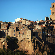 "PITIGLIANO, ITALY - OCTOBER 23: A view of Pitigliano, a small village located in Tuscany halfway from Florence and Rome, perched atop a volcanic tufa ridge. Its unmistakable skyline makes it stand out. Pitigliano is a truly unique village in southern Tuscany, in the less-known Maremma district. The town is dubbed ""la citta' di tufo"" for the rock that it not only is built on.<br /> The village is also called ""Little Jerusalem"", not just because it looks ancient and bears a resemblance to that city, but also for the long presence of a Jewish community in the town. Pitigliano, Tuscany, Italy. 23rd October 2017. Photo by Tim Clayton/Corbis via Getty Images)"