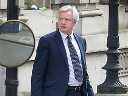 © Licensed to London News Pictures. 30/03/2017. London, UK. Brexit Sectretary David Davis leaves his office in Downing Street for Parliament. Photo credit: Peter Macdiarmid/LNP