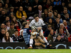 Ospreys' Sam Davies is tackled by Cardiff Blues' Blaine Scully<br /> <br /> Photographer Simon King/Replay Images<br /> <br /> Guinness PRO14 Round 21 - Cardiff Blues v Ospreys - Saturday 28th April 2018 - Principality Stadium - Cardiff<br /> <br /> World Copyright © Replay Images . All rights reserved. info@replayimages.co.uk - http://replayimages.co.uk