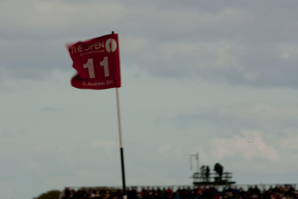 ST. ANDREWS, SCOTLAND - JULY 16: A flag at the 11th green flaps in strong wind during the second round of the Open Championship at the Old Course on July 16 2010 in St. Andrews, Scotland. (Photo by Darren Carroll)