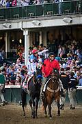 Jockey of Medina Spirit, John Velazquez celebrates his victory after winning the 147th Kentucky Derby at Churchill Downs.<br /> <br /> (Photo by William DeShazer)