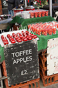 Christmas toffee apples for sale in Covent Garden on the 11th December 2018 in London in the United Kingdom.