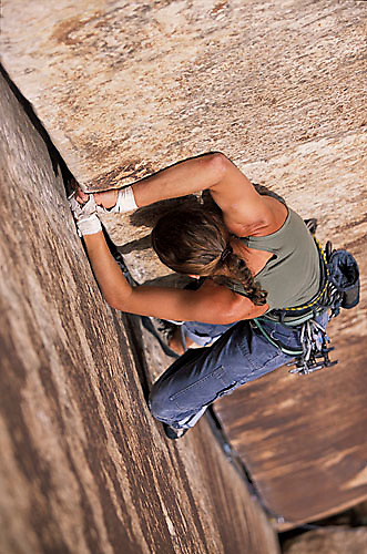 Sasha Musso climbing unknown 5.9 at the Blue Gramma Wall in Indian Creek, UT.<br />