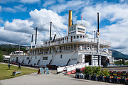 """The SS Klondike No. 2 sternwheeler, launched at Whitehorse in 1937, was the largest vessel ever to sail the Canadian portion of the Yukon River. The SS Klondike No 2 moved silver-lead ore, freight, and passengers primarily between Whitehorse and Dawson, until retirement in 1955 ended the era of commercial steamboats in the Yukon. It's now a National Historic Site in Whitehorse, the capital and largest city of Yukon, Canada. Whitehorse was incorporated in 1950 at kilometer 1426 (Historic Mile 918) on the Alaska Highway. Whitehorse lies on the Yukon River, which originates in British Columbia, is light-colored from glacial runoff, and meets the Bering Sea in Alaska. Whitehorse was named after the White Horse Rapids for their resemblance to the mane of a white horse, near Miles Canyon, before the river was dammed. The name Yukon comes from a Gwich'in phrase meaning white water river. Although historically and popularly called """"Yukon Territory"""", the territory is now officially called """"Yukon"""" (after the federal government's Yukon Act in 2002)."""