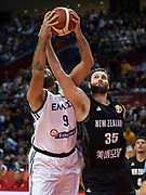 NANJING,CHINA:SEPTEMBER 5th 2019.FIBA World Cup Basketball 2019 Group phase match.Group F. New Zealand vs Greece. Center, Alex PLEDGER (R) tries to get the ball from Greece's Center Ioannis BOUROUSIS.Photo by Jayne Russell / www.PhotoSport.nz