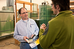 Dave Borud of Northerm Windows describes the company's product at their Whitehorse manufacturing plant