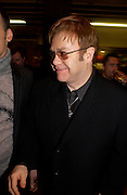 Sir Elton John. Party hosted by Isabella Blow in honour of Shaun Leane to celebrate his jewelry collection. Liberty's. London. 8 December 2004. ONE TIME USE ONLY - DO NOT ARCHIVE  © Copyright Photograph by Dafydd Jones 66 Stockwell Park Rd. London SW9 0DA Tel 020 7733 0108 www.dafjones.com