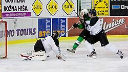 Nik Ulaga of HK Olimpija vs Ryan Klingensmith of HK Partizan during ice-hockey match between HK Olimpija and HK Partizan at second game in Final round of SLOHOKEJ league, on Februar 18, 2012 at Hala Tivoli, Ljubljana, Slovenia. (Photo By Matic Klansek Velej / Sportida)