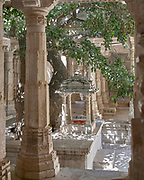 A shady courtyard shrine within the magnificent Jain Temple at Ranakpur, near the city of Udaipur in Rajasthan India