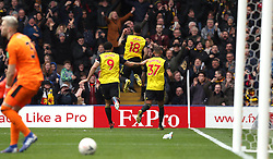 Watford's Andre Gray (centre) celebrates scoring his side's second goal of the game with team-mates during the FA Cup quarter final match at Vicarage Road, Watford.