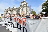 """20 SEP 2019, BERLIN/GERMANY:<br /> Demonstratinnen mit Transparent """"OUR FUTURE ON YOUR SHOULDERS"""", Fridays for Future Demonstration für Massnahmen zur  Begrenzung des Klimawandels, vor dem Reichstagsgebaeude, Scheidemannstrasse <br /> IMAGE: 20190920-01-064<br /> KEYWORDS: Demo, Demonstrant, Protest, Protester, Demonstration, Klima, climate, change, Maedchen, Mädchen, Frauen, Schueler, Schuelerinnen, Schüler, Schülerinnen"""