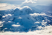 Mount Rainier aerial view, dotted with clouds, Washington, USA