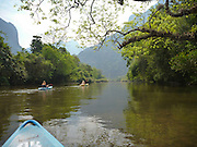 Kayaking on the Nam Song River near Vang Vieng, Laos.