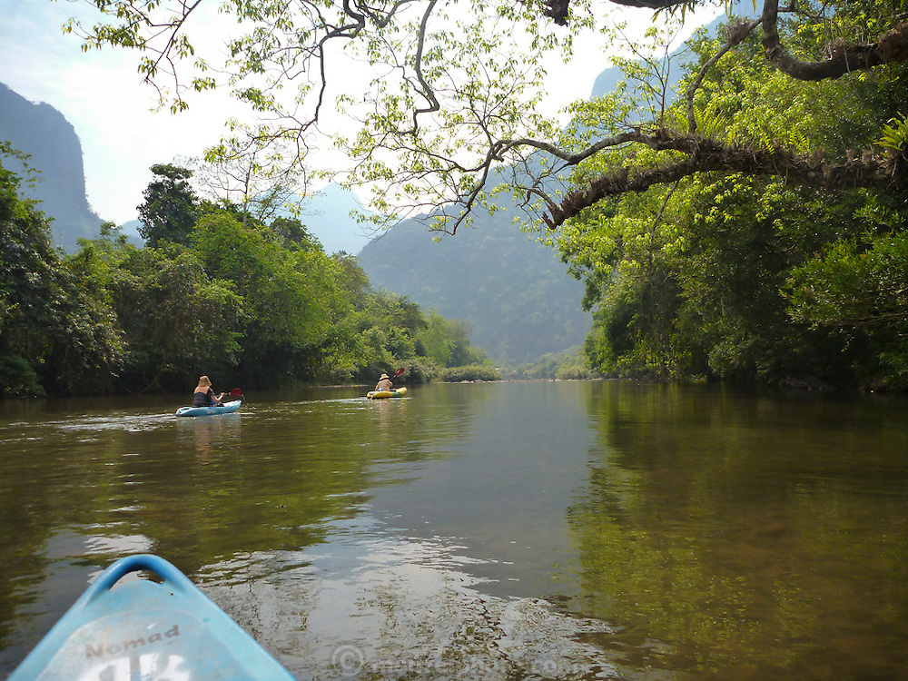 Kayaking on the Nam Song River near Vang Vieng, Laos.