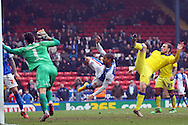Simeon Jackson of Blackburn Rovers (c) acrobatically shoots and scores his teams 1st goal to make it 1-2. Skybet football league Championship match, Blackburn Rovers v Leeds United at Ewood Park in Blackburn, Lancs on Saturday 12th March 2016.<br /> pic by Chris Stading, Andrew Orchard sports photography.