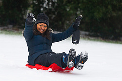Mum Priya gets in on the sledging action as people and their pets enjoy the three inches of snow on Hampstead Heath in North London. Hampstead, London, February 01 2019.