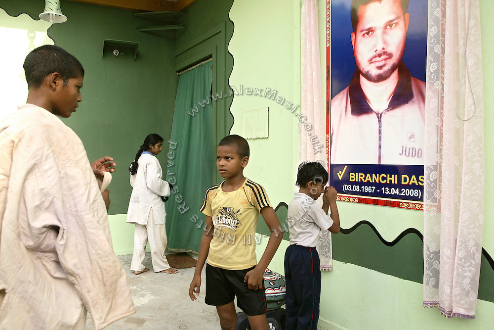 Judo students are paying homage to an image of Biranchi Das, the recently murdered coach of Budhia Singh, in his former Judo Hall, in Bhubaneswar, the capital of Orissa State, on Saturday, May 17, 2008. On May 1, 2006, Budhia completed a record breaking 65 km run from Jagannath temple, Puri to Bhubaneswar. He was accompanied by his coach Biranchi Das and by the Central Reserve Police Force (CRPF). On 8th May 2006, a Government statement had ordered that he stopped running. The announcement came after doctors found the boy had high blood pressure and cardiological stress. As of 13th August 2007 Budhia's coach Biranchi Das was arrested by Indian police on suspicion of torture. Singh has accused his coach of beating him and withholding food. Das says Singh's family are making up charges as a result of a few petty rows. On April 13, Biranchi Das was shot dead in Bhubaneswar, in what is believed to be an event unconnected with Budhia, although the police is investigating the case and has made an arrest, a local goon named Raja Archary, which is now in police custody. **Italy and China Out**