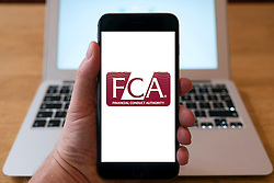 FCA , Financial Conduct Authority , website on iPhone smart phone mobile phone