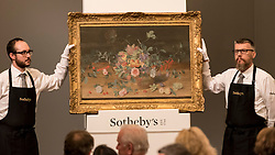 "© Licensed to London News Pictures. 06/07/2016. London, UK.  ""Still life with a basket of flowers and fruit"" by Isaak Soreau, which sold for a hammer price of GBP 0.19m (est GBP 0.15-0.2m) at Sotheby's Old Masters evening sale in New Bond Street. Photo credit : Stephen Chung/LNP"