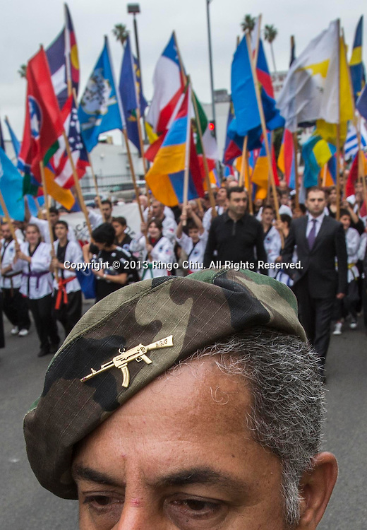 A demonstrator wears army hat as thousands of Armenians protest to mark the 98th anniversary of the beginning of the Armenian genocide and to call on the Turkish government to recognize the deaths of about 1.5 million people, in Los Angeles on Wednesday, April 24, 2013.  (Photo by Ringo Chiu/PHOTOFORMULA.com).