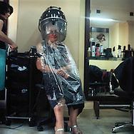 Hair saloon client having her hair done.