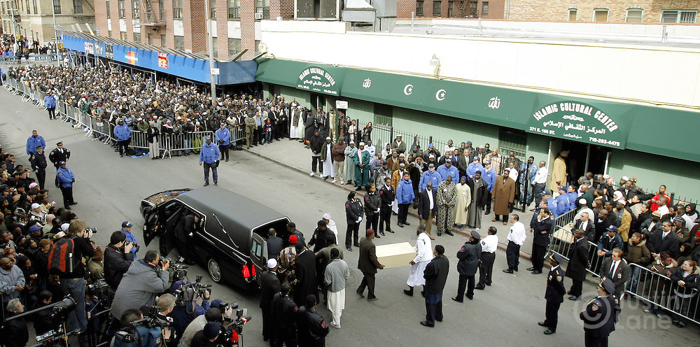 The coffin of one of the ten people killed in a recent house fire is carried from the Islamic Cultural Center in the Bronx, New York on Monday 12 March 2007. Of the ten people killed in the fire, 9 were children, and all were immigrants from Mali.