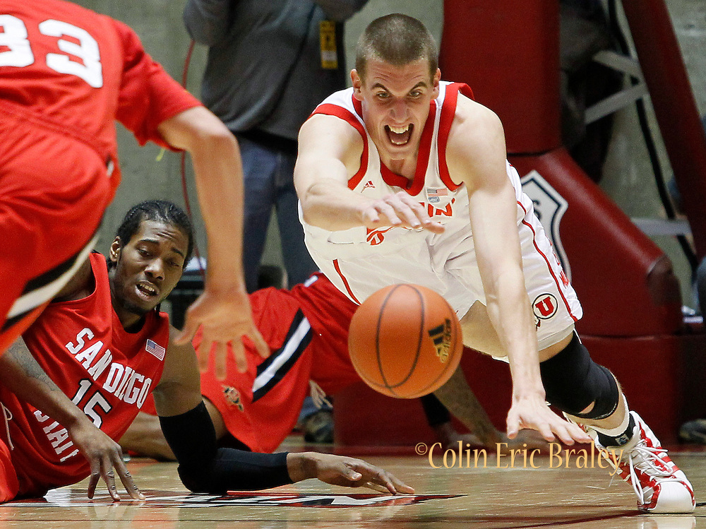 Utah center David Foster (51) dives after a loose ball after stealing it away from San Diego State forward Kawhi Leonard (15) during the first half of an NCAA college basketball game, Saturday, Jan. 8, 2011, in Salt Lake City, Utah. (AP Photo/Colin E Braley)