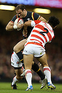 Jamie Roberts of Wales tries to break away from Shota Horie of Japan.  Under Armour 2016 series international rugby, Wales v Japan at the Principality Stadium in Cardiff , South Wales on Saturday 19th November 2016. pic by Andrew Orchard, Andrew Orchard sports photography