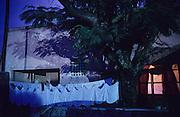 NIGHTIME HAZE, Amazon, near Boavista, northern Brazil, South America. Strange lighting at night in the town near burning rainforest. Purple clouds blow across the skies.