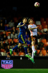 April 6, 2017 - Valencia, Valencia, Spain - Santi Mina (R) of Valencia CF heads the ball next to Hugo Mallo of Real Club Celta de Vigo during the La Liga match between Valencia CF and Real Club Celta de Vigo at Mestalla Stadium on April 6, 2017 in Valencia, Spain. (Credit Image: © David Aliaga/NurPhoto via ZUMA Press)