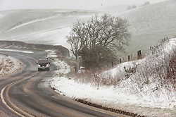 © Licensed to London News Pictures. 30/01/2021. Llanfihangel Nant Melan, Powys, Wales, UK. Motorists drive through a blizzard on the A44 road near Llanfihangel nant Melan in Powys, Wales, UK. Photo credit: Graham M. Lawrence/LNP