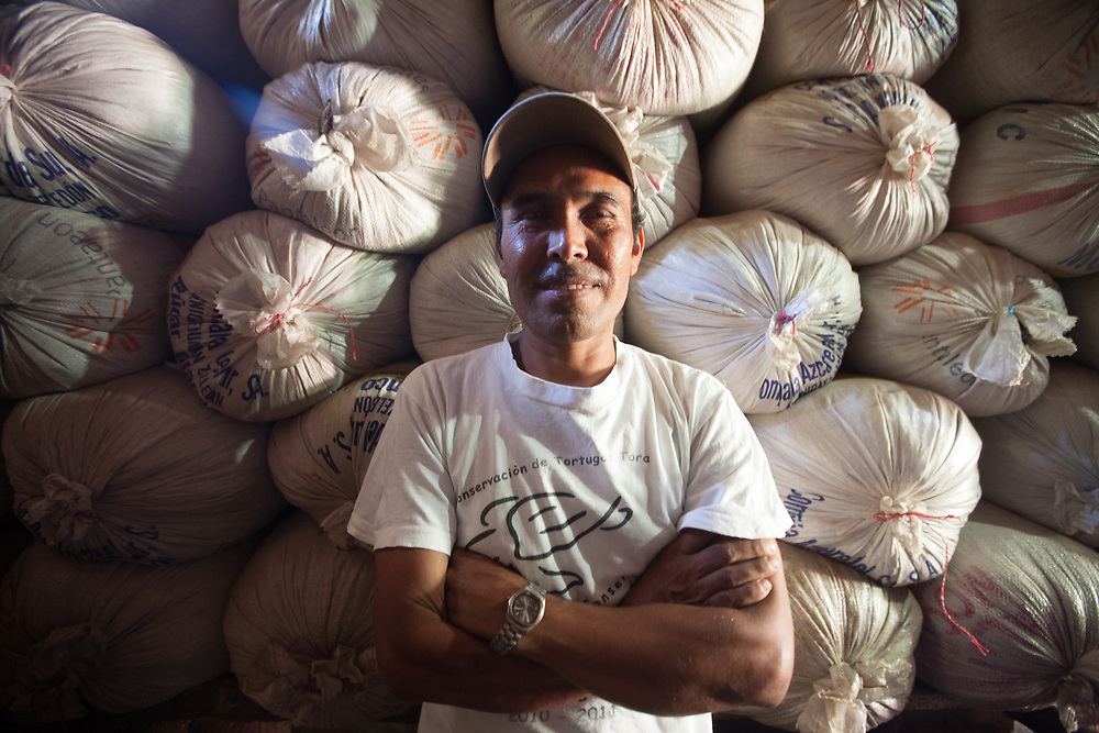 Juan Manual Verroterán with 46 quintal sacks of rice he has just harvested with the technical support of CIEETS. He will use 6 quintals for his own family consumption and sell the rest.