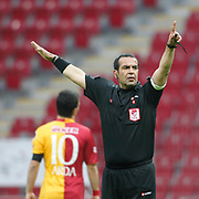 Referee's Bunyamin GEZER during their Turkish superleague soccer derby match Galatasaray between Trabzonspor at the TT Arena in Istanbul Turkey on Sunday, 10 April 2011. Photo by TURKPIX