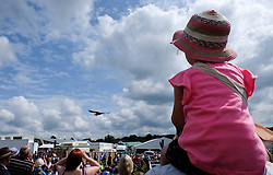 © Licensed to London News Pictures.14/07/15<br /> Harrogate, UK. <br /> <br /> A young girl watches an eagle fly overhead during a bird of prey demonstration on the opening day of the Great Yorkshire Show.  <br /> <br /> England's premier agricultural show opened it's gates today for the start of three days of showcasing the best in British farming and the countryside.<br /> <br /> The event, which attracts over 130,000 visitors each year displays the cream of the country's livestock and offers numerous displays and events giving the chance for visitors to see many different countryside activities.<br /> <br /> Photo credit : Ian Forsyth/LNP