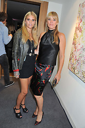 Left to right, TIGERLILY TAYLOR and her mother DEBBIE LENG at the Shopbop.com at Home event held at Neo Bankside, London on 15th September 2012.