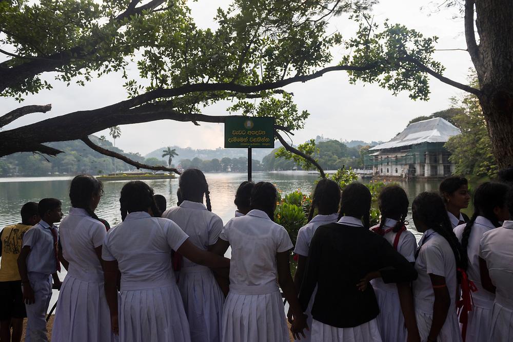 A group of Sri Lankan school girls enjoy the view of Kandy Lake in the city of Kandy, Sri Lanka (April 1, 2017)
