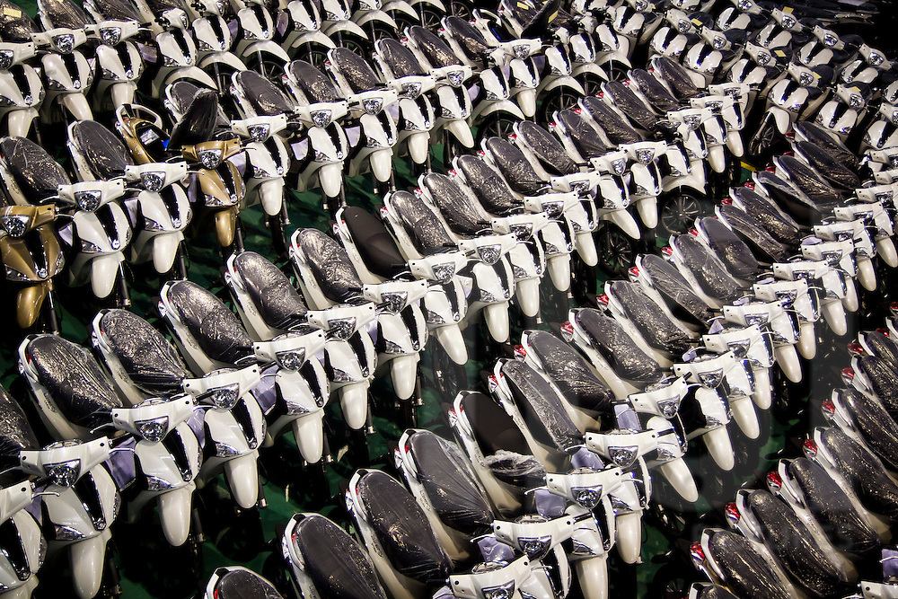 Completed Vespas at the end of the assembly line at the Piaggio Factory outside Hanoi, Vietnam