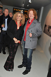 SUZANNE WYMAN and MICK HUCKNALL  at a private view of Bill Wyman - Reworked held at the Rook & Raven Gallery, 7 Rathbone Place, London W1 on 26th February 2013.
