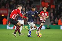 Football - 2018 / 2019 Premier League - Southampton vs. Manchester United<br /> <br /> Marcus Rashford of Manchester United drives past Southampton's Jannik Vestergaard at St Mary's Stadium Southampton<br /> <br /> COLORSPORT/SHAUN BOGGUST